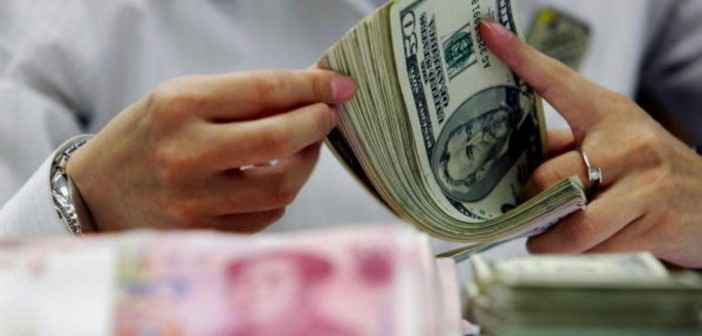 CHINA OUT A bank teller counts the stack